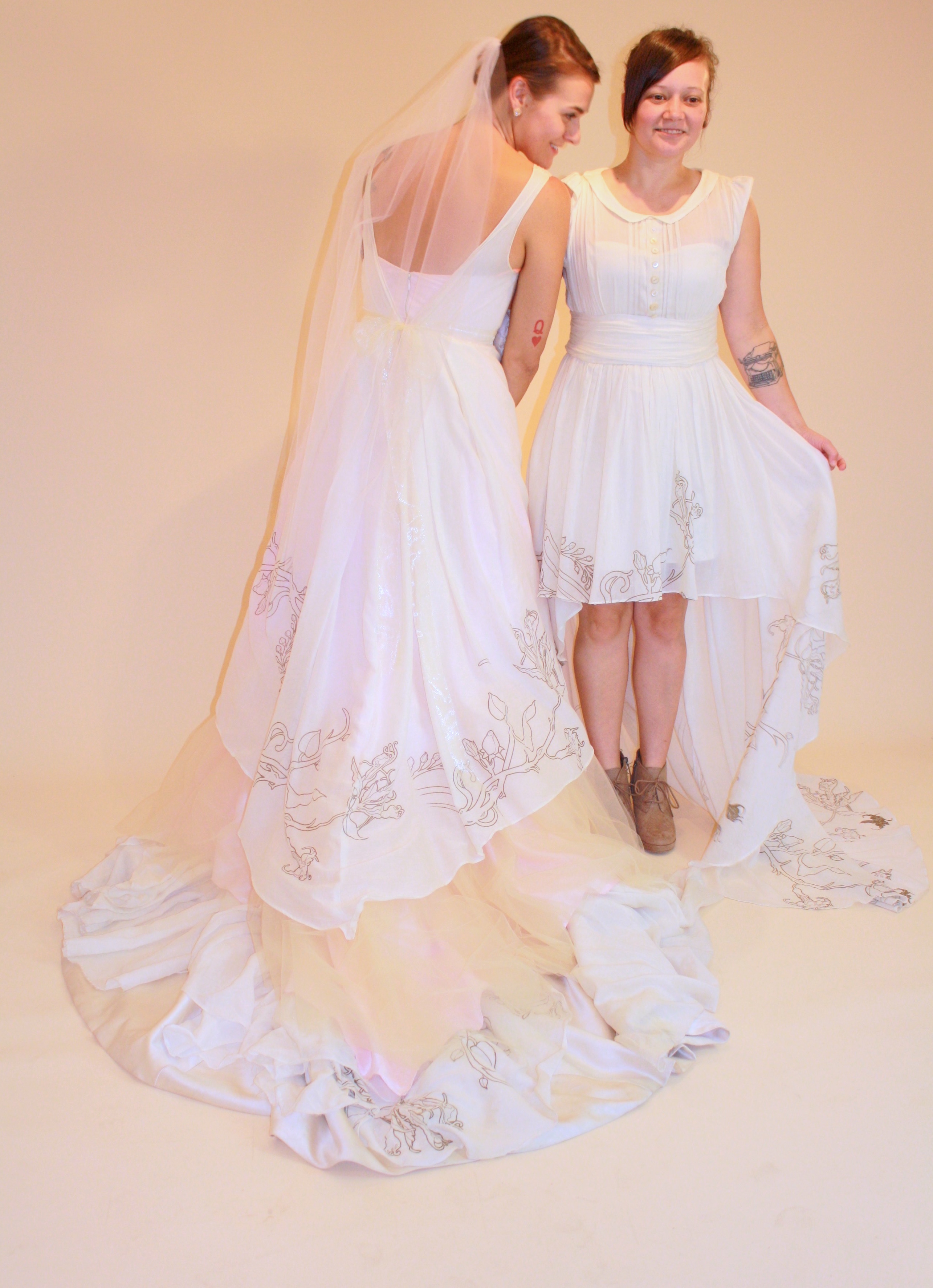 Couple in wedding dresses