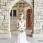 bride in lace sheath wedding gown stone arch wedding photography alterations by janay a kansas city