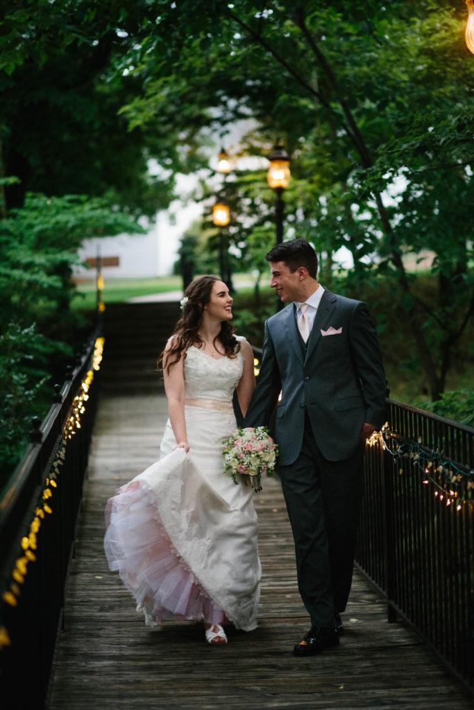 Sarah Mountray handmade gown walking on bridge
